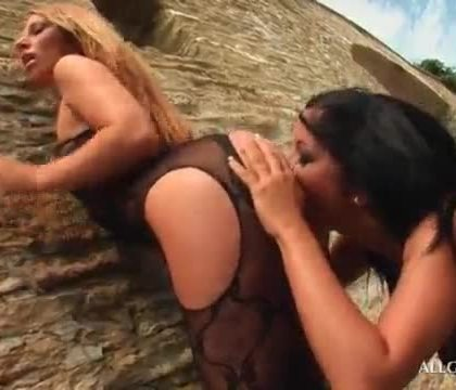 Blonde lesbo pussy licked from behind against the wall
